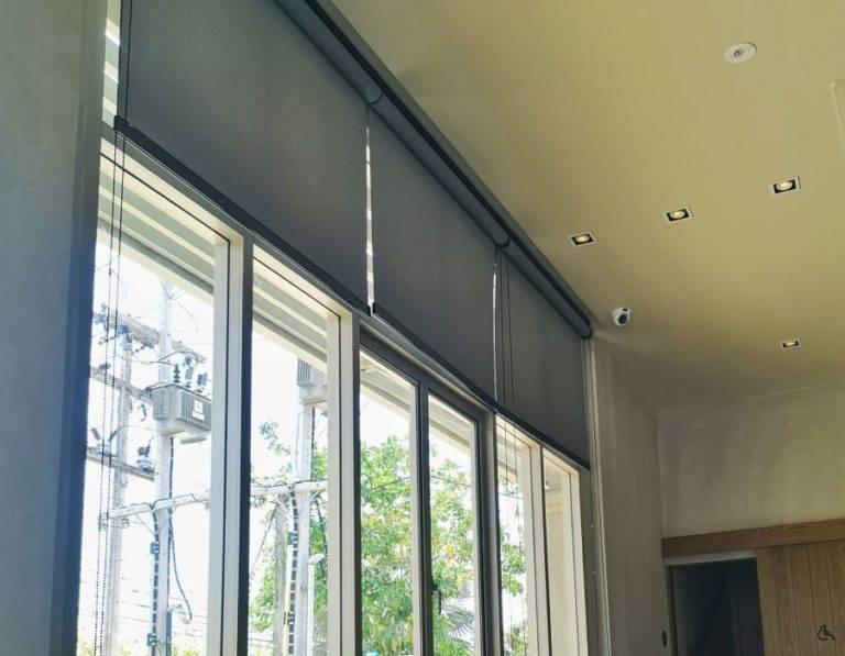 commercial dark grey roller blinds in office