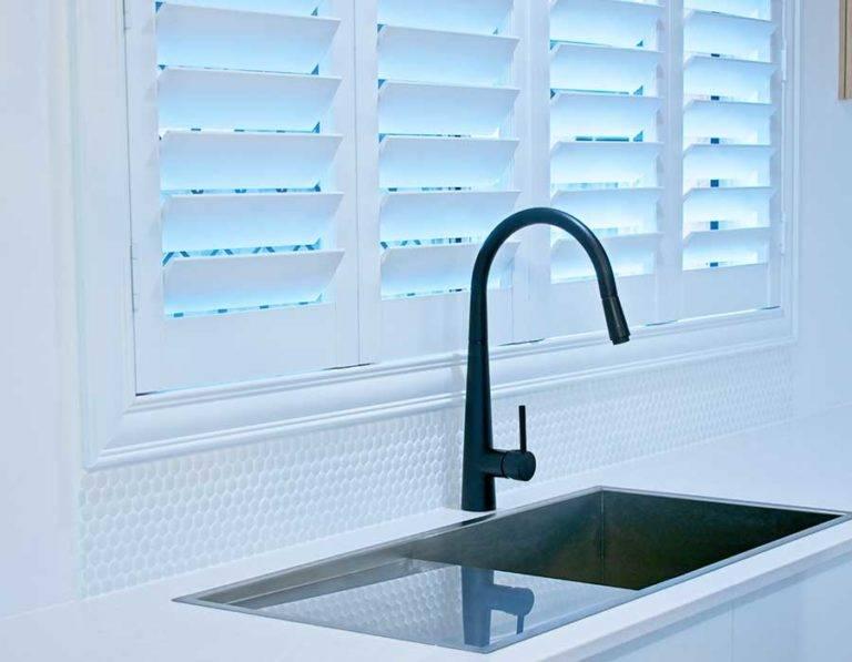 plantation shutters by kitchen sink